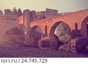 Купить «Evening photo of medieval bridge over river. Besalu», фото № 24745729, снято 15 октября 2018 г. (c) Яков Филимонов / Фотобанк Лори