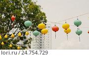 Купить «Multicolored lights hanging on the street of Nha Trang», видеоролик № 24754729, снято 21 декабря 2016 г. (c) Mikhail Davidovich / Фотобанк Лори