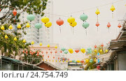 Купить «Multicolored lights hanging on the streets of Nha Trang. Asia.», видеоролик № 24754749, снято 21 декабря 2016 г. (c) Mikhail Davidovich / Фотобанк Лори