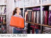 Купить «Woman choosing new bed linen», фото № 24756661, снято 21 января 2020 г. (c) Яков Филимонов / Фотобанк Лори