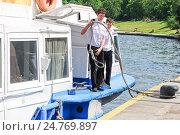 Купить «Персонал теплохода со швартовным канатом», эксклюзивное фото № 24769897, снято 5 июня 2012 г. (c) Алёшина Оксана / Фотобанк Лори