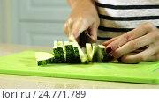 Купить «Cooking ratatouille. Female hands cutting zucchini into slices on plastic cutting board. HD», видеоролик № 24771789, снято 22 декабря 2016 г. (c) ActionStore / Фотобанк Лори