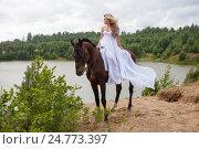 Купить «Девушка в белом развивающимся платье верхом на лошади», эксклюзивное фото № 24773397, снято 16 июля 2016 г. (c) Литвяк Игорь / Фотобанк Лори