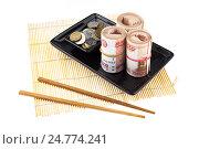Купить «Роллы из пятитысячных банкнот на блюде для суши», фото № 24774241, снято 19 апреля 2019 г. (c) OSHI / Фотобанк Лори
