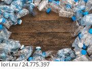 Купить «Смятые пластиковые бутылки на деревянном столе», фото № 24775397, снято 14 декабря 2016 г. (c) Галаганов Дмитрий Александрович / Фотобанк Лори