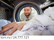 Купить «Man Doing Laundry Reaching Inside Washing Machine», фото № 24777121, снято 31 октября 2014 г. (c) easy Fotostock / Фотобанк Лори