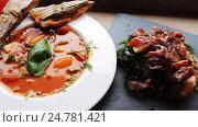 Купить «gazpacho soup, salads and drink at restaurant», видеоролик № 24781421, снято 29 сентября 2016 г. (c) Syda Productions / Фотобанк Лори