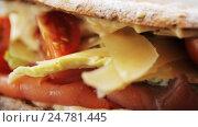 Купить «salmon panini sandwich at restaurant», видеоролик № 24781445, снято 29 сентября 2016 г. (c) Syda Productions / Фотобанк Лори