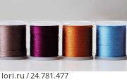 Купить «row of colorful thread spools on table», видеоролик № 24781477, снято 3 октября 2016 г. (c) Syda Productions / Фотобанк Лори
