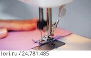 Купить «sewing machine presser foot stitching fabric», видеоролик № 24781485, снято 3 октября 2016 г. (c) Syda Productions / Фотобанк Лори