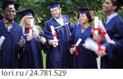 Купить «happy students in mortar boards with diplomas», видеоролик № 24781529, снято 6 октября 2016 г. (c) Syda Productions / Фотобанк Лори