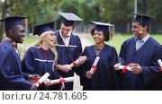 Купить «happy students in mortar boards with diplomas», видеоролик № 24781605, снято 6 октября 2016 г. (c) Syda Productions / Фотобанк Лори