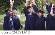 Купить «happy students in mortar boards with diplomas», видеоролик № 24781613, снято 6 октября 2016 г. (c) Syda Productions / Фотобанк Лори