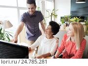 Купить «happy creative team with computer in office», фото № 24785281, снято 29 марта 2015 г. (c) Syda Productions / Фотобанк Лори
