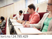 Купить «group of students with notebooks in lecture hall», фото № 24785429, снято 19 июня 2016 г. (c) Syda Productions / Фотобанк Лори