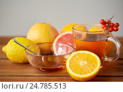 Купить «tea with honey, lemon and rowanberry on wood», фото № 24785513, снято 13 октября 2016 г. (c) Syda Productions / Фотобанк Лори