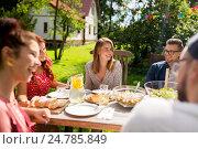 Купить «happy friends having dinner at summer garden party», фото № 24785849, снято 28 августа 2016 г. (c) Syda Productions / Фотобанк Лори