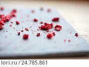 Купить «dried raspberries or berries on stone plate», фото № 24785861, снято 22 сентября 2016 г. (c) Syda Productions / Фотобанк Лори