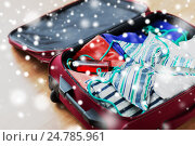 Купить «close up of travel bag with bikini and clothes», фото № 24785961, снято 9 февраля 2016 г. (c) Syda Productions / Фотобанк Лори