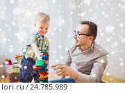 Купить «father and son playing with toy blocks at home», фото № 24785989, снято 19 марта 2016 г. (c) Syda Productions / Фотобанк Лори