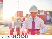 Купить «happy builders and architect at construction site», фото № 24786013, снято 21 сентября 2014 г. (c) Syda Productions / Фотобанк Лори