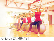 Купить «group of people working out in pilates class», фото № 24786481, снято 28 сентября 2013 г. (c) Syda Productions / Фотобанк Лори