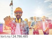 Купить «builders pointing finger at you on construction», фото № 24786485, снято 21 сентября 2014 г. (c) Syda Productions / Фотобанк Лори