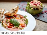 Купить «goat cheese salad and gazpacho soup at restaurant», фото № 24786581, снято 22 сентября 2016 г. (c) Syda Productions / Фотобанк Лори