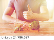 Купить «close up of male hands showing food rich in fiber», фото № 24786697, снято 14 мая 2015 г. (c) Syda Productions / Фотобанк Лори