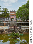 Купить «View of The Precious Wall (Buu Thanh) and entrance gate to the Royal Crypt (Huyen Cung). Tomb of Tu Duc, Hue, Vietnam.», фото № 24804665, снято 19 марта 2019 г. (c) age Fotostock / Фотобанк Лори
