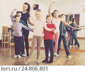 Купить «diligent little boys and girls dancing pair dance», фото № 24806801, снято 12 ноября 2016 г. (c) Яков Филимонов / Фотобанк Лори