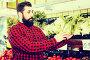 man seller showing salad, фото № 24813981, снято 15 ноября 2016 г. (c) Яков Филимонов / Фотобанк Лори