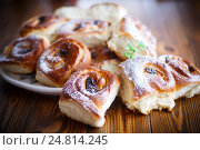 Купить «sweet rolls with raisins», фото № 24814245, снято 5 января 2017 г. (c) Peredniankina / Фотобанк Лори