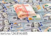 Купить «Folded stack of five thousandths banknotes of russian roubles on dollars background», фото № 24814605, снято 4 января 2017 г. (c) FotograFF / Фотобанк Лори