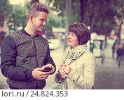 Купить «man points the direction with smartphone», фото № 24824353, снято 25 октября 2016 г. (c) Яков Филимонов / Фотобанк Лори