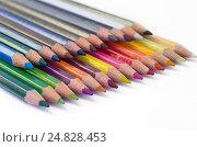 Купить «Цветные карандаши на белом ватмане», фото № 24828453, снято 17 апреля 2016 г. (c) Елена Коромыслова / Фотобанк Лори