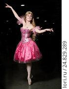 Купить «Балерина в розовом платье танцует на темном фоне», фото № 24829289, снято 20 ноября 2016 г. (c) Антон Гвоздиков / Фотобанк Лори