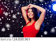Купить «beautiful sexy woman in red dancing at nightclub», фото № 24830961, снято 25 сентября 2015 г. (c) Syda Productions / Фотобанк Лори