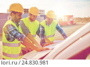 Купить «close up of builders with blueprint on car hood», фото № 24830981, снято 21 сентября 2014 г. (c) Syda Productions / Фотобанк Лори