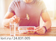 Купить «close up of man with fork and water eating food», фото № 24831005, снято 14 мая 2015 г. (c) Syda Productions / Фотобанк Лори