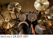 Купить «male musician playing drums and cymbals at concert», фото № 24831081, снято 18 августа 2016 г. (c) Syda Productions / Фотобанк Лори