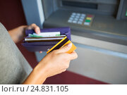 Купить «hands with money and credit card at atm machine», фото № 24831105, снято 8 сентября 2016 г. (c) Syda Productions / Фотобанк Лори
