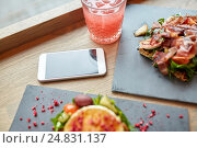 Купить «goat cheese and ham salads with smartphone at cafe», фото № 24831137, снято 22 сентября 2016 г. (c) Syda Productions / Фотобанк Лори