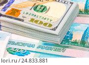 Купить «Stack of one hundred american dollar bills over roubles background», фото № 24833881, снято 16 августа 2018 г. (c) FotograFF / Фотобанк Лори