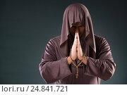 Купить «Monk in religious concept on gray background», фото № 24841721, снято 26 октября 2016 г. (c) Elnur / Фотобанк Лори