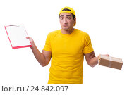 Купить «Man delivering christmas present isolated on white», фото № 24842097, снято 31 октября 2016 г. (c) Elnur / Фотобанк Лори