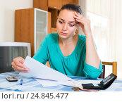 Купить «Sad woman with bills at the table», фото № 24845477, снято 23 октября 2018 г. (c) Яков Филимонов / Фотобанк Лори