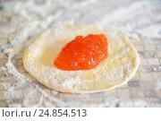 Купить «Apricot jam on dough for preparation of pies», фото № 24854513, снято 6 января 2017 г. (c) Володина Ольга / Фотобанк Лори