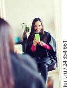 Купить «happy young woman at hair salon», фото № 24854661, снято 15 февраля 2015 г. (c) Syda Productions / Фотобанк Лори