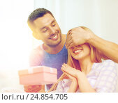 Купить «smiling man surprises his girlfriend with present», фото № 24854705, снято 9 февраля 2014 г. (c) Syda Productions / Фотобанк Лори